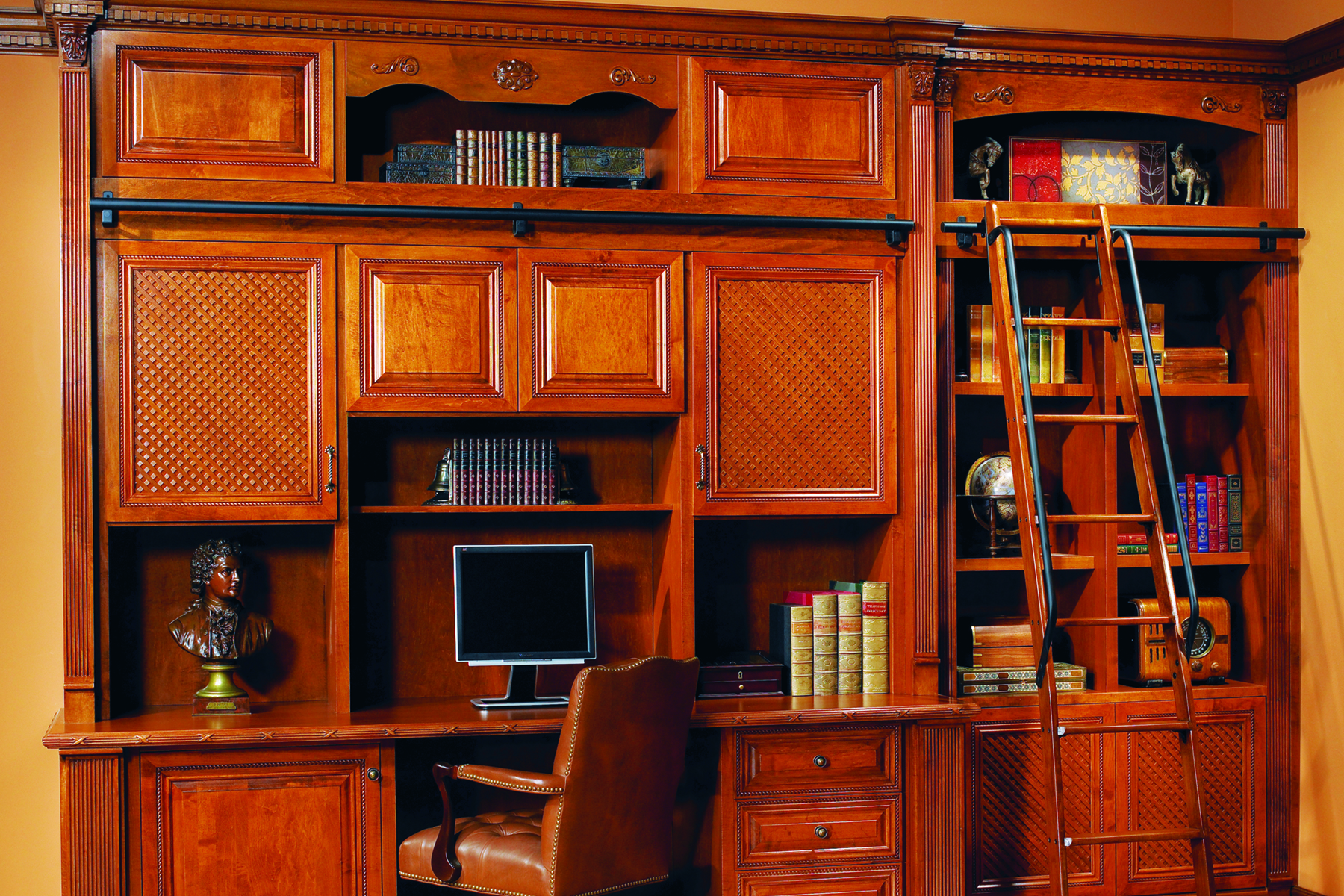Probably the type of home library you'd find in anyone's home. Tall but not necessarily wide. Useful nonetheless. If you're living alone and only need a particular space for your books which you'll utilize as a work area as well then I strongly recommend that you opt for this style. Due to the height, you also need a rolling ladder. Perfect for someone wanting to grab their favourite books while they work.