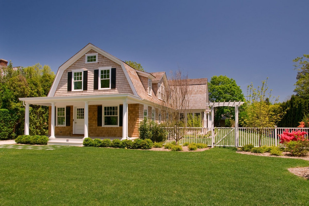 End of the gambrel roof serves as front of the home. Dormers are different styles including sloped and gable.