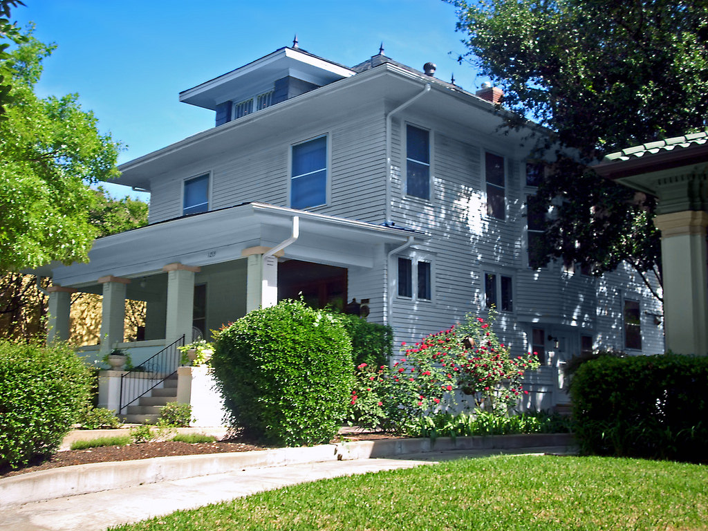 Classic plain style American foursquare home with small windows (most have larger windows).
