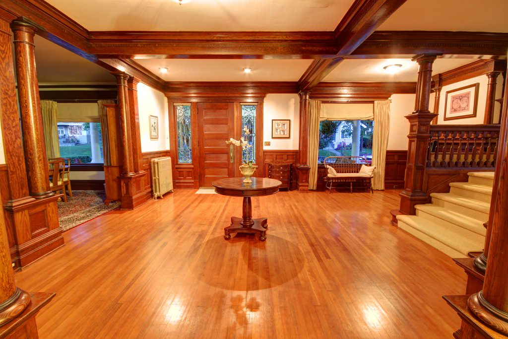 Spectacular foyer with original woodwork in an American Foursquare home