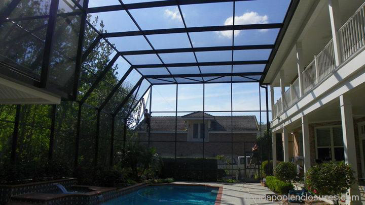 Inside of a 2-story pool screen enclosure