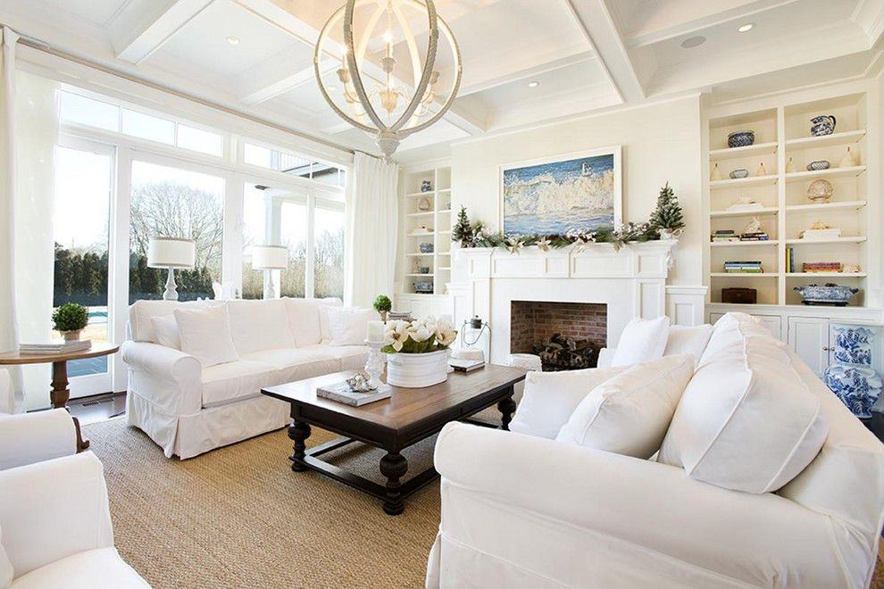 Blue and brown make a wonderful combination with white as the walls, ceiling, fireplace, shelves and sofa set are flooded with white colors.