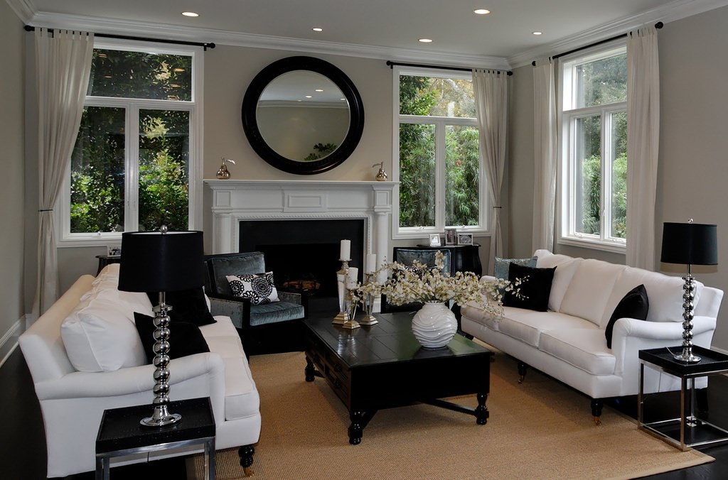 An Elegant Living Room Dominated By Black And White Where The White Sofa  Set Is Paired
