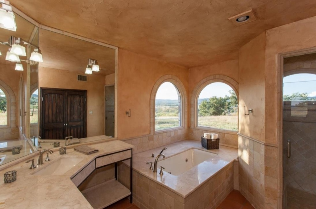 Arched Windows Flanking Bathtub