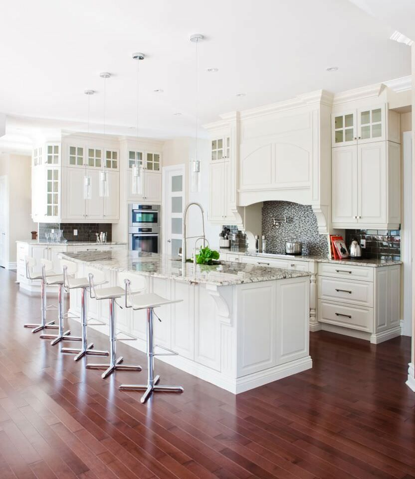 Genial Gorgeous White Kitchen With Double Stainless Steel Wall Ovens Tucked In The  Corner Of The Kitchen