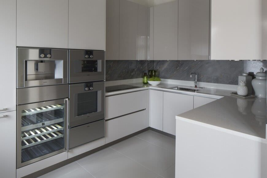 Small White Kitchen With Double Wall Oven.