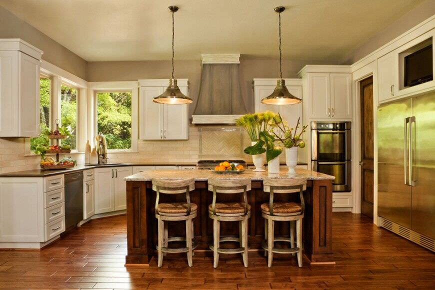 Elegant kitchen with wood floor, beautiful custom island and a double wall oven.