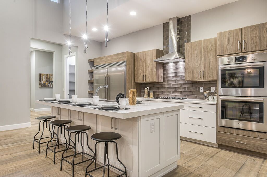 Contemporary Kitchen With Plank Wood Style Floor, White And Natural Wood  Cabinets And A Large