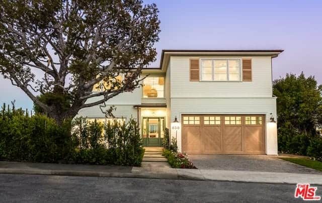Beach Chic Farmhouse Home with Great Ceiling Heights, an Open Layout, and Multiple Outdoor Patios