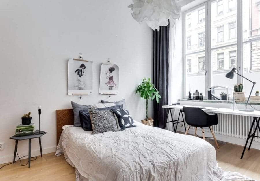 White Scandinavian-Style primary bedroom featuring a study desk near the window with elegant black and white window curtains.
