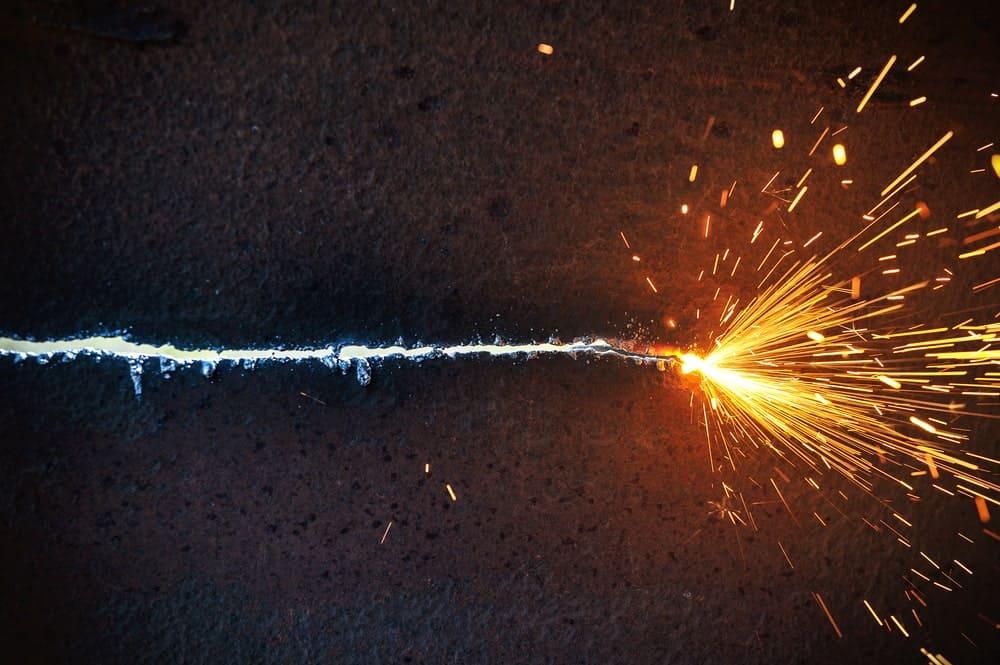 Welding cutting through a sheet metal.