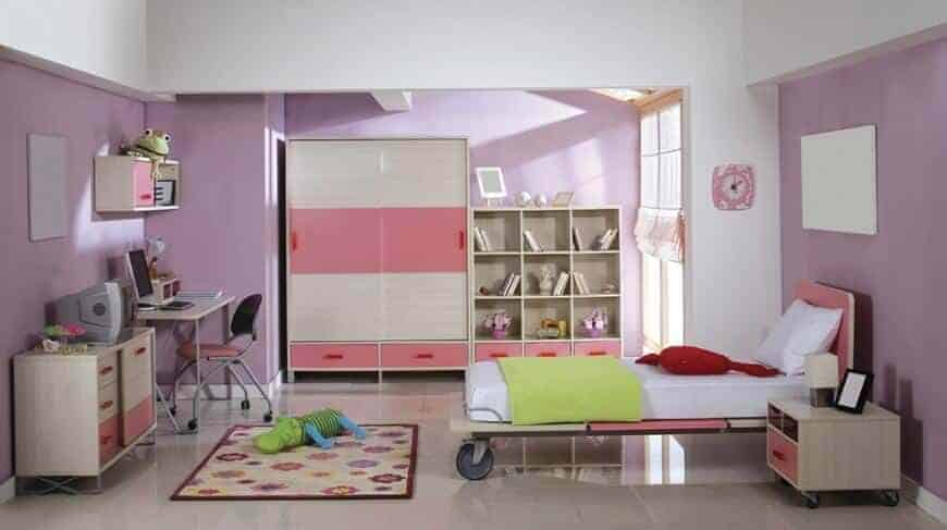 Purple bedroom with wooden nightstand and a sleek bed on wheels. It is accompanied by storage cabinets and desk paired with a metal chair.