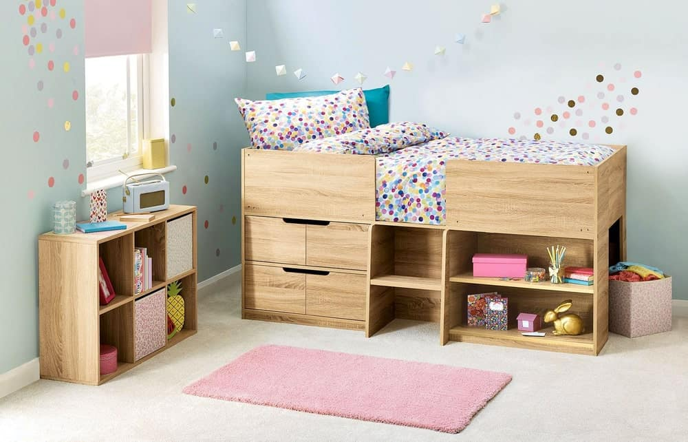 This bedroom offers a pink area rug and an open shelving unit that matches the wooden loft bed with storage underneath.