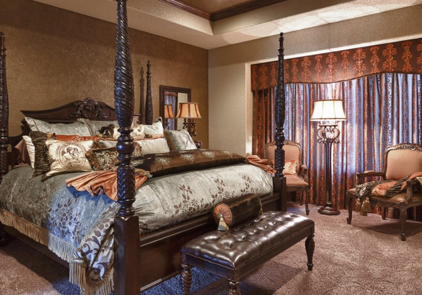 Sophisticated master bedroom features a carved wood four poster bed accompanied by a tufted leather bench and cushioned armchairs that are lighted by a classic floor lamp.