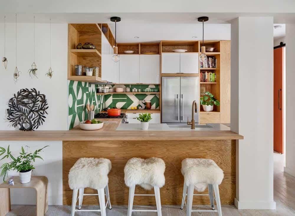 Prospect Park Apartment kitchen interior with peninsula island, stylish kitchen backsplash, and open shelving surrounding the glossy white flat panel cabinetry.