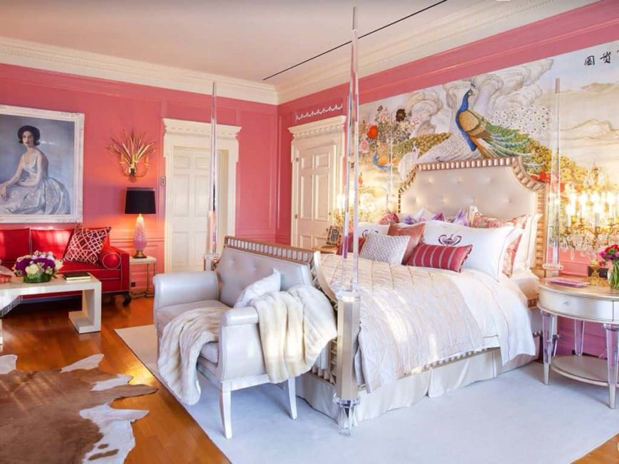 This women's master bedroom boasts artistic wall decors on its pink walls. The room has a lovely bed set along with a small sitting space on the side.