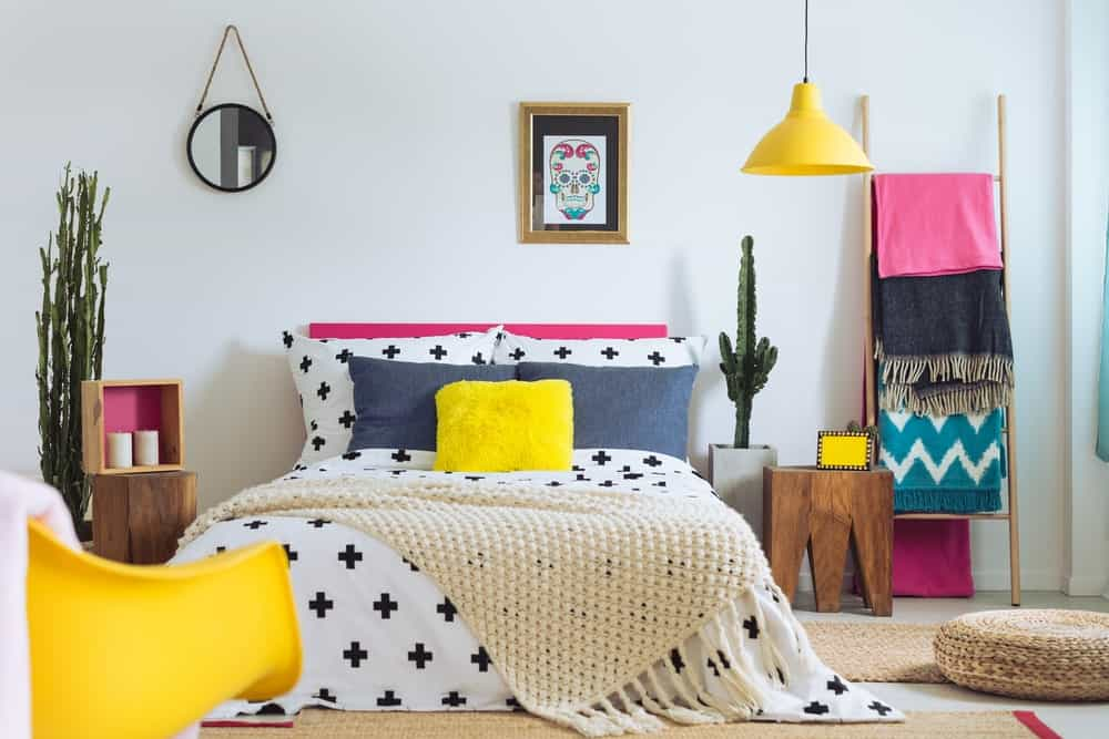 Bedroom with colorful accessories.