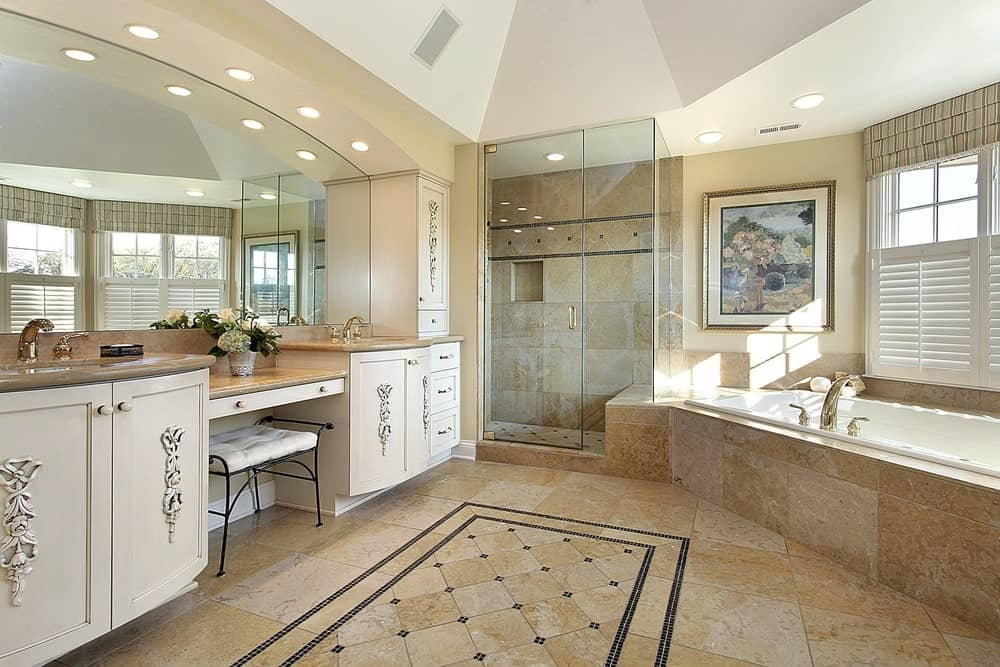 A gorgeous painting above the bathtub adds a nice accent in this master bathroom with a walk-in shower and dual sink vanity inlaid with ornate carvings.