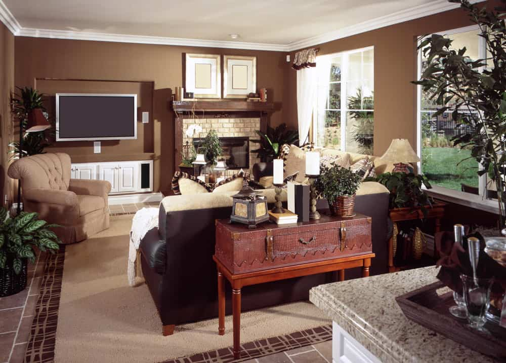 This family living space features a cozy sofa set and a large widescreen TV on the wall beside the fireplace.