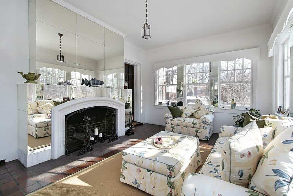 Large formal living space with a beautiful set of seats and a large modern fireplace.