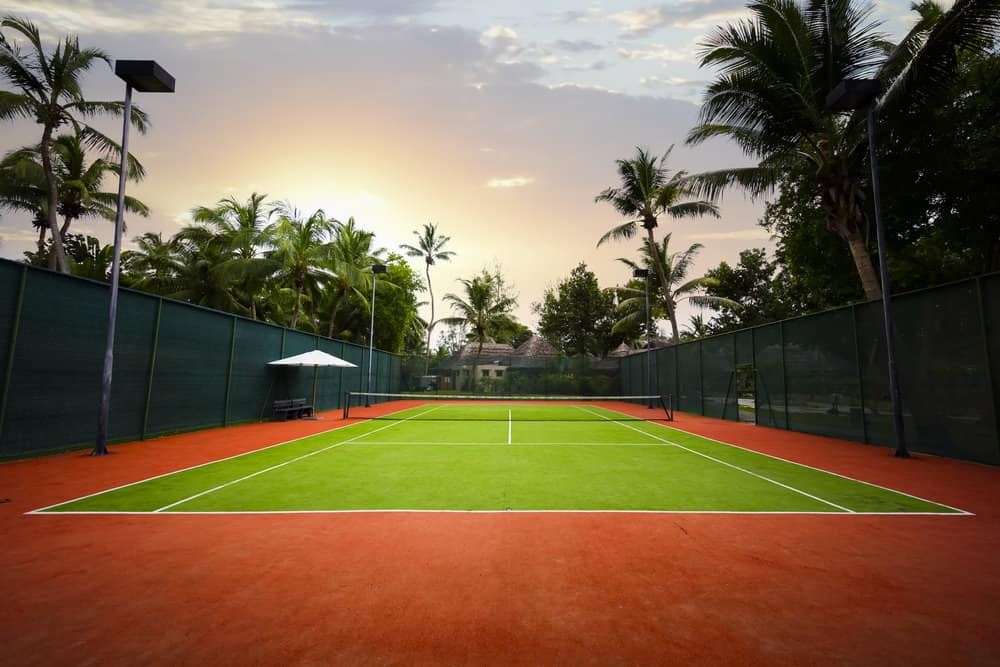 Beautiful red and green tennis court in tropical location