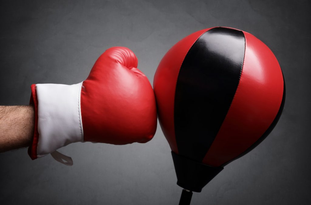 Punching a red punch bag