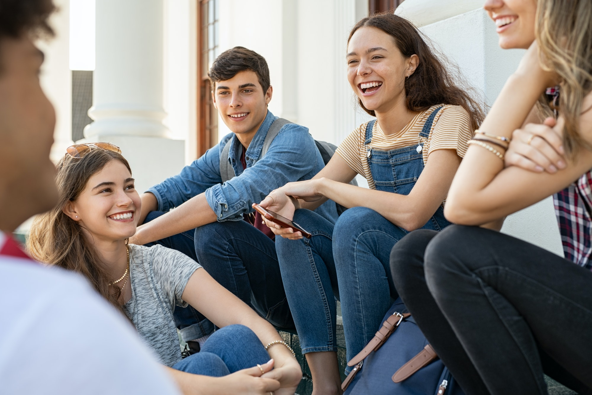 Teenager friends sitting together and laughing