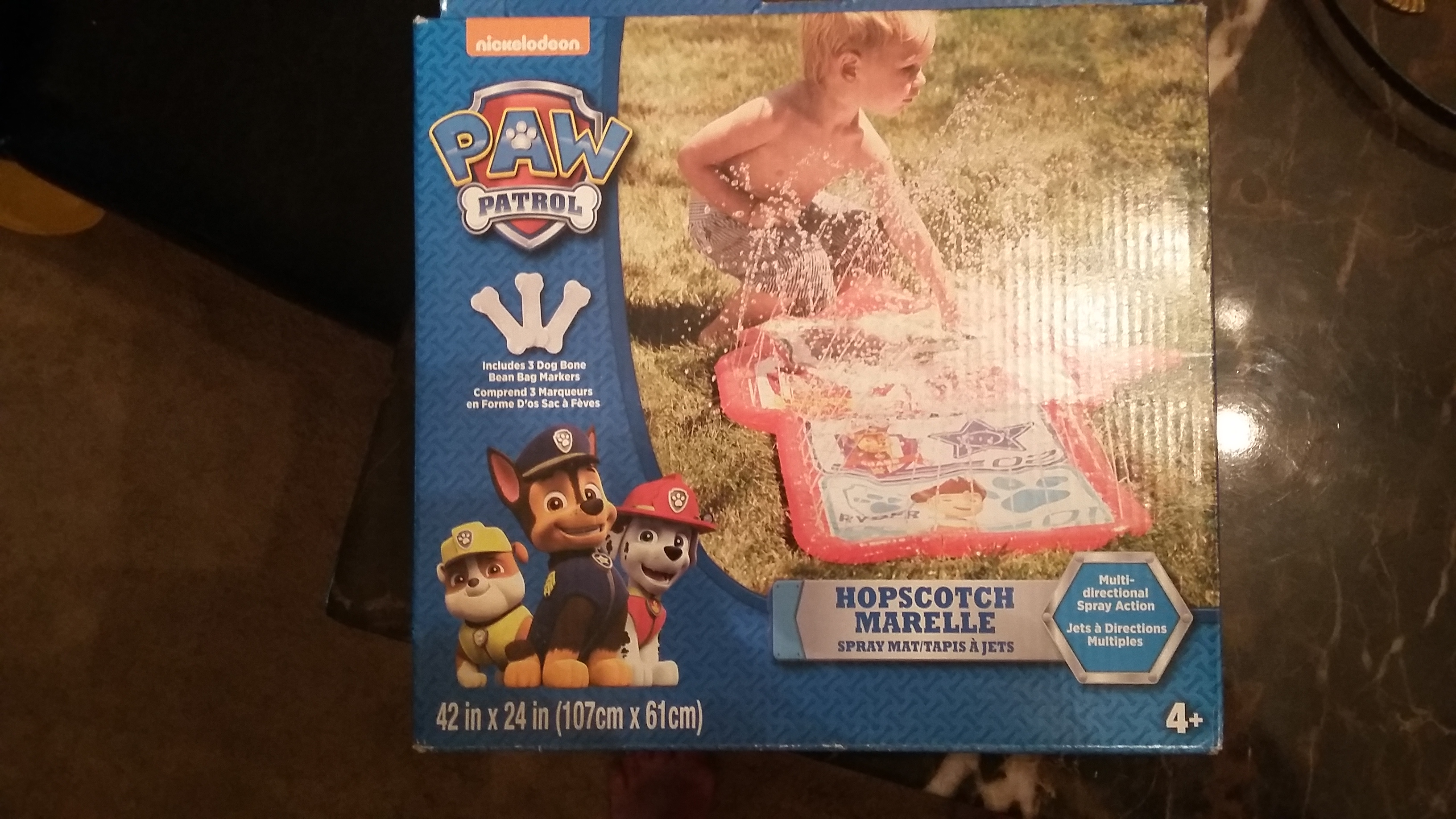 new in box multi-directional splash mat for toddlers too (box says 4+)