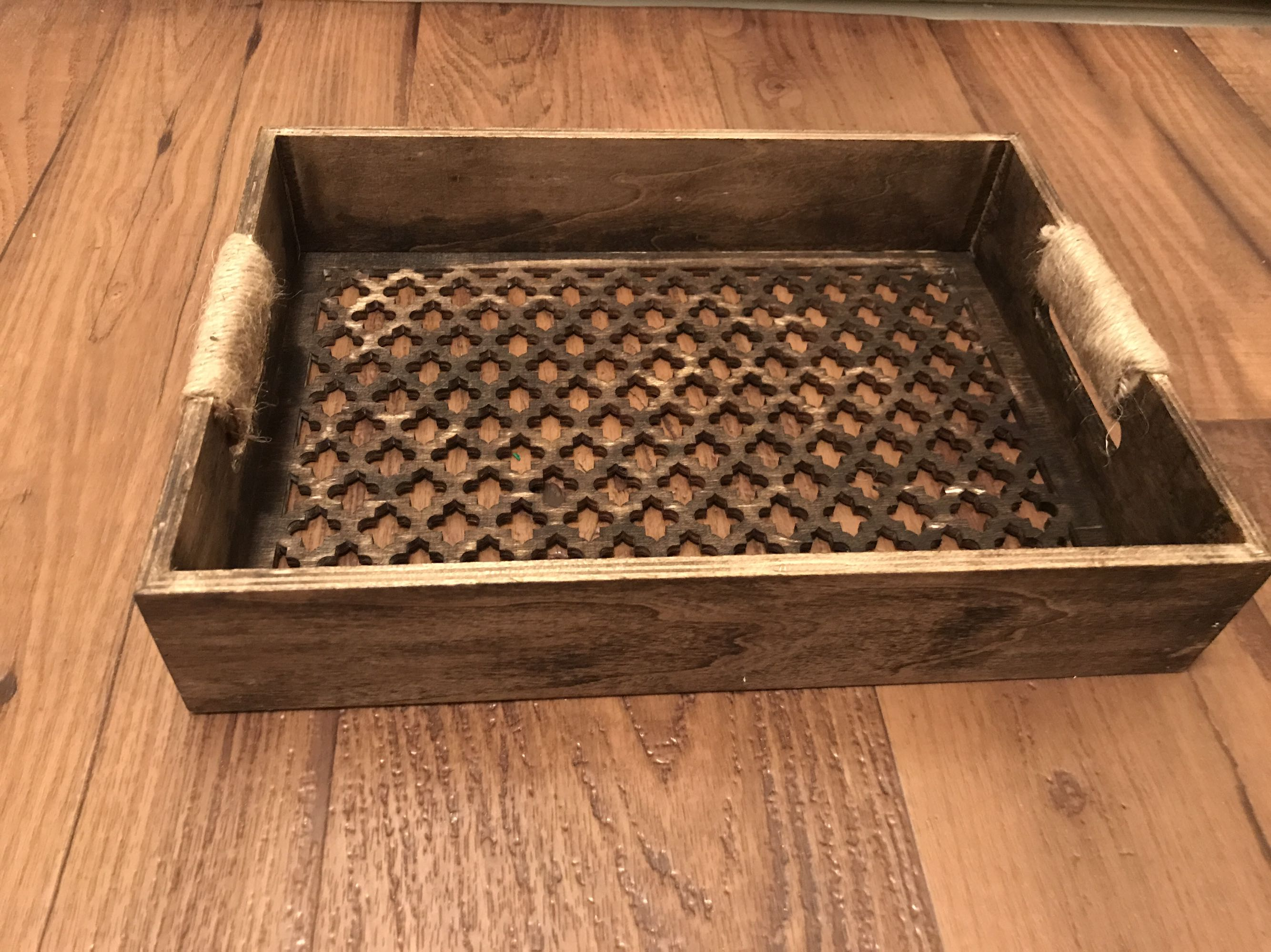 Super cute wooden tray with twine accents.