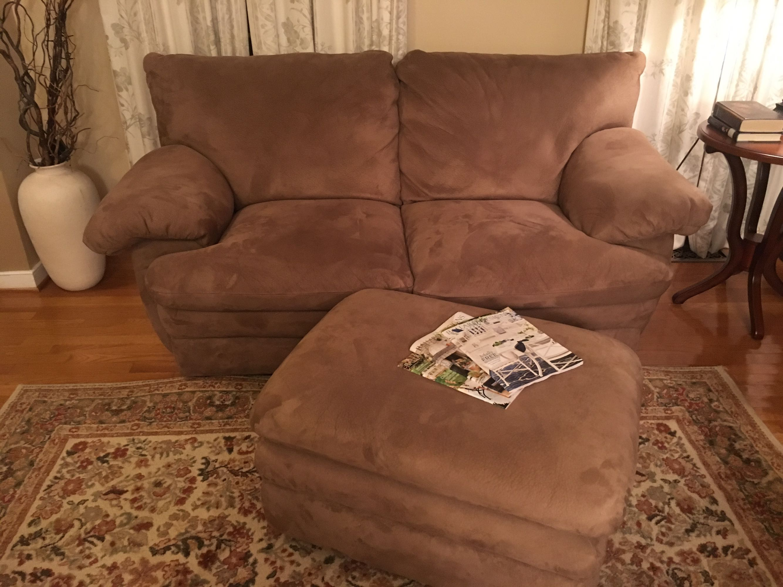 Brown suede loveseat and ottoman