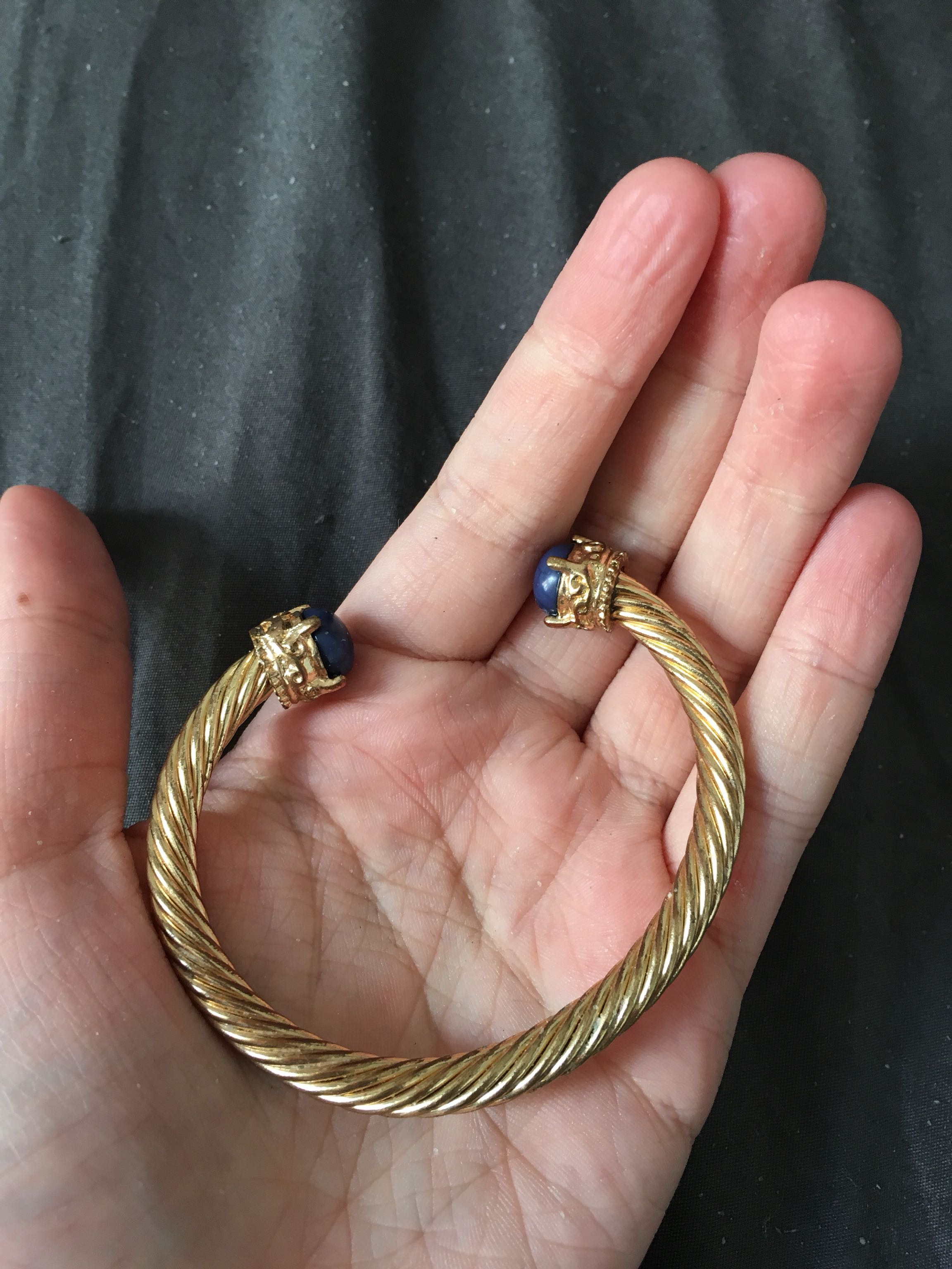 Topshop plated gold bangle with dark blue stones
