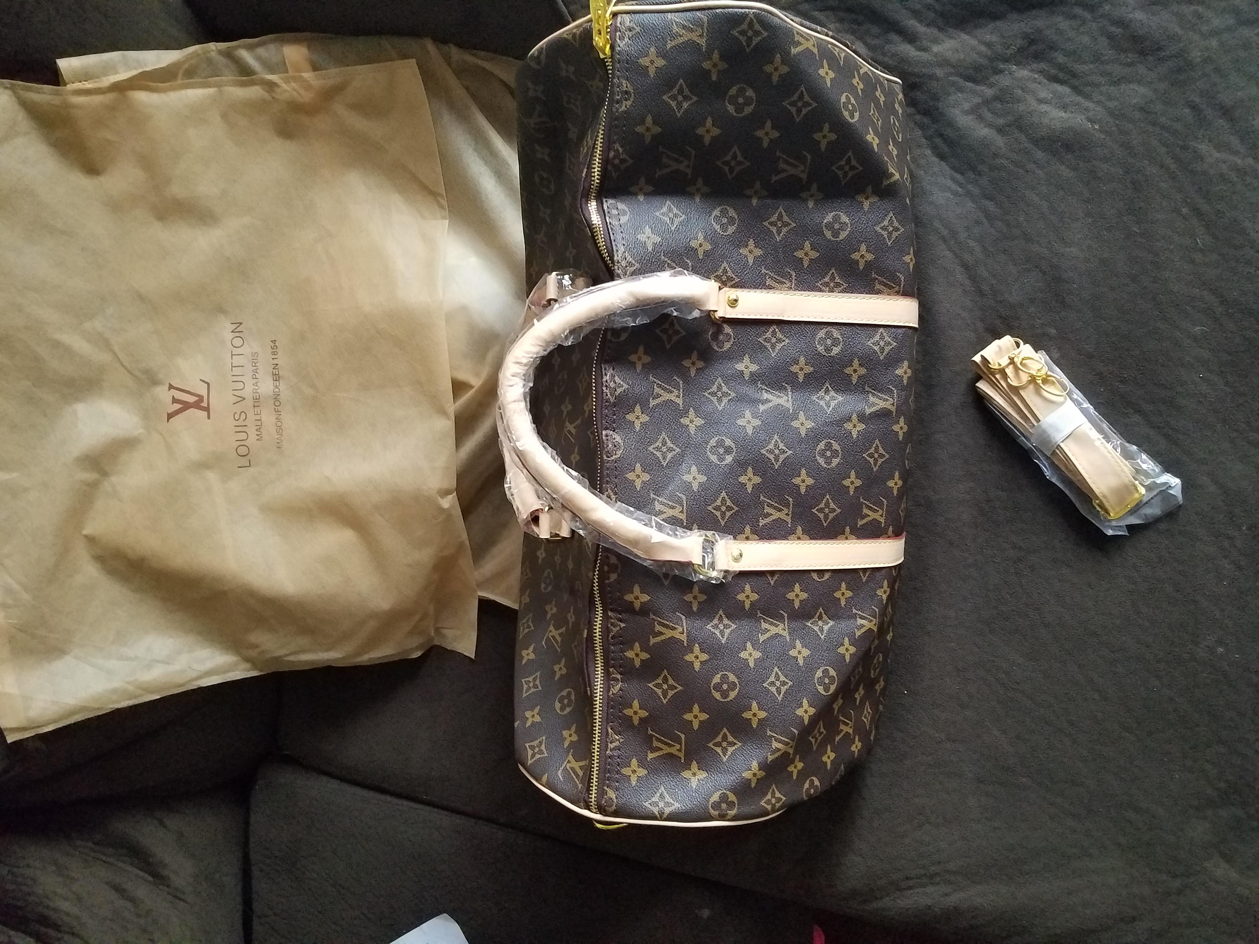 Louis Vuitton BRAND NEW duffle bag