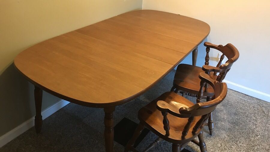 Brown wooden table with four chairs dining set