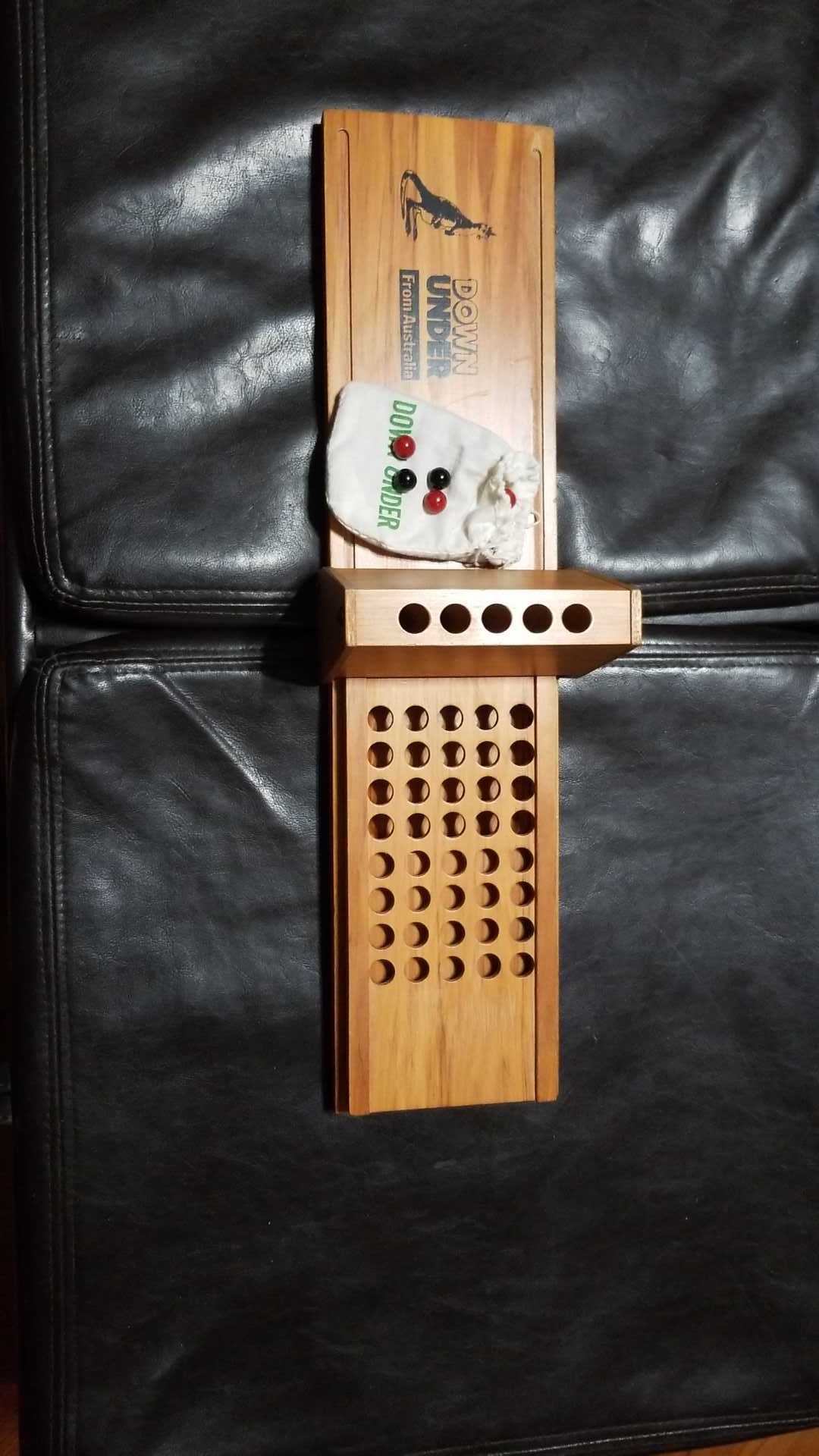 Australian pub game with marbles. Like harder Connect 4.