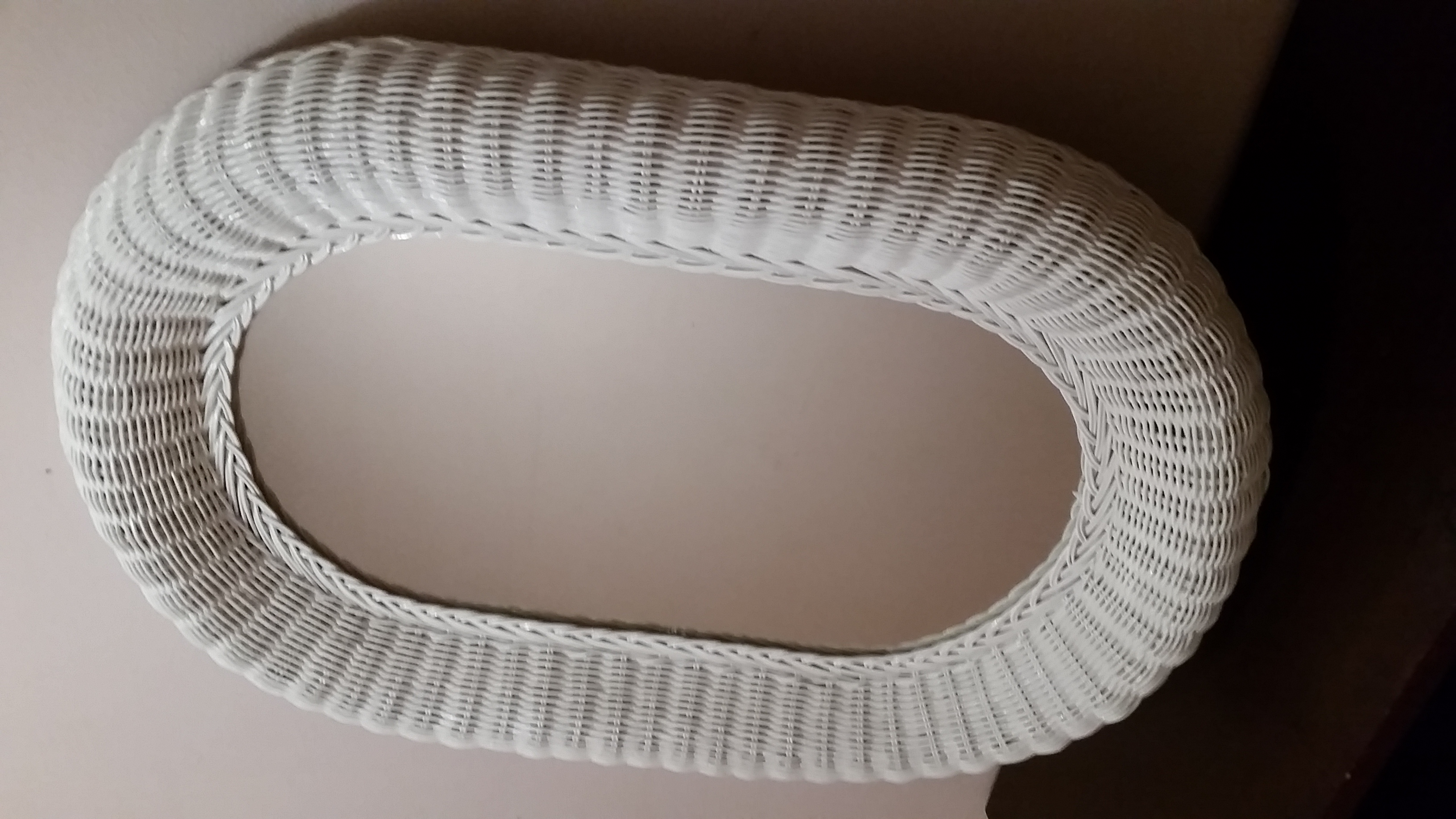 In Mint condition (one owner) Vintage 1960's white wicker LG OVAL mirror, price is $120.00 NO MORE & ABSOLUTELY WILL NOT BE LESS.