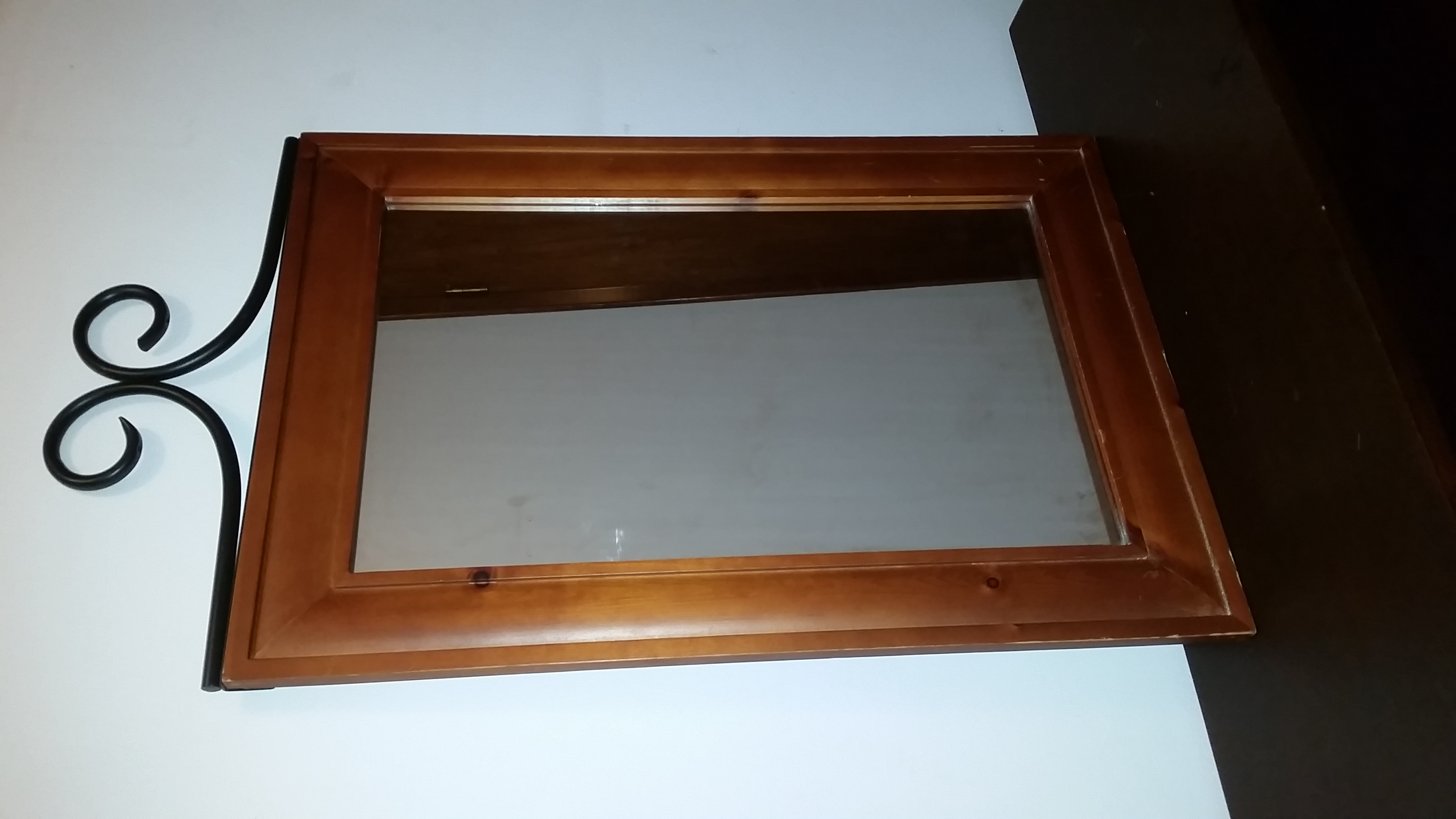 Solid wood, black iron wall mirror. In EUC. $10.00 NO MORE & NO LESS PRICE IS WHAT IT IS & STAYING.
