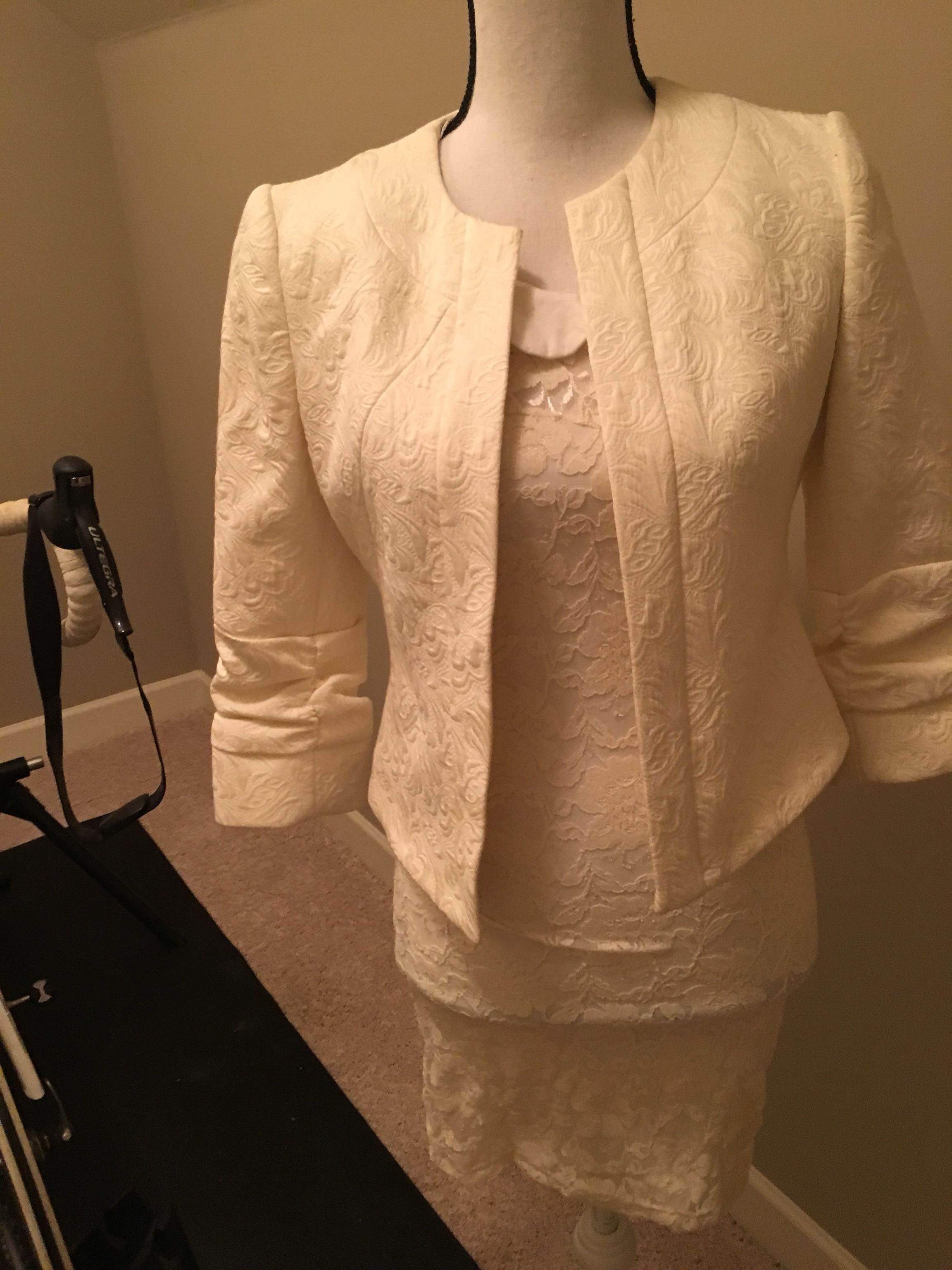 Ivory lace dress with peck and peck ivory jacket