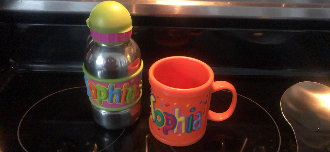 Bottle of water and cup with Sophia name.