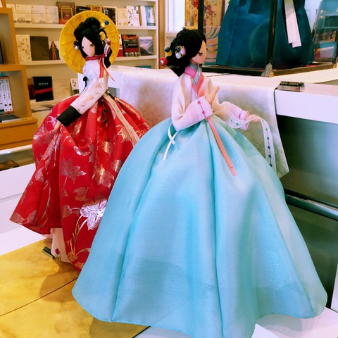 delicate dolls in traditional costumes