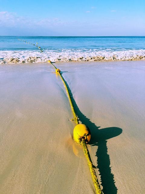 wave-washed buoy rope