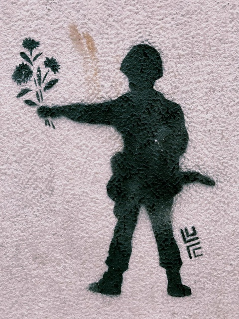 Lisbon graffiti: soldier with flowers