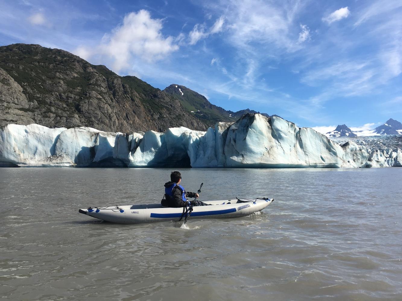 Kayaker in front of a glacier in Alaska
