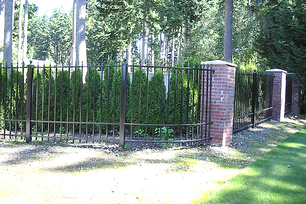 Classic wrought iron and brick commercial gates