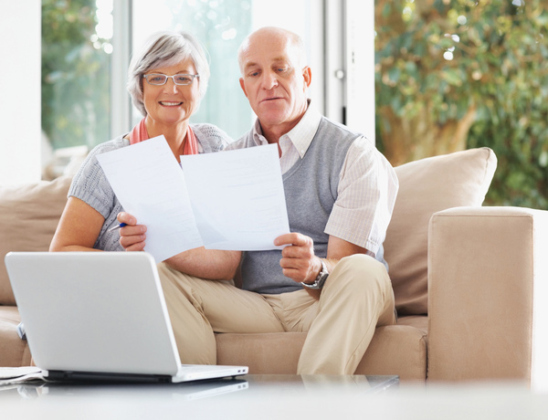 Couple Looking over Sunset Funeral Home General Price List