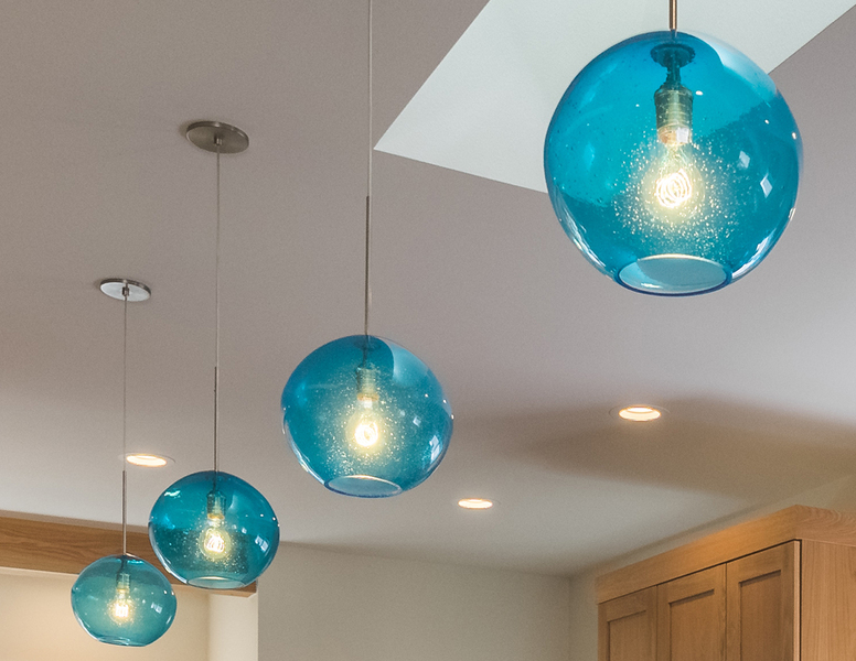 designer lighting with blue glass spherical lamps
