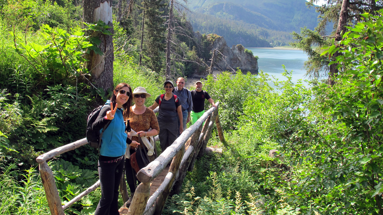 Hikers on a bridge in Kachemak State Park