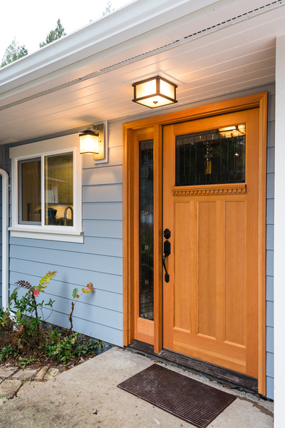 front exterior door of ranch house remodel by Bellingham home builders with modern porch light