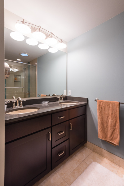 ranch house remodel by Bellingham home builders, bathroom remodel with double sinks, vanity mirror with lights, dark cabinets