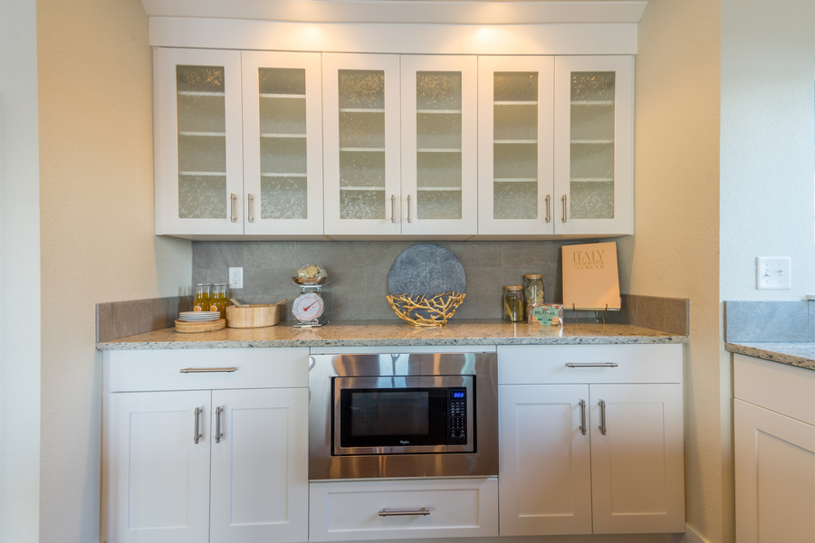 kitchen remodel of beach house with custom glass cabinets, built in microwave by Bellingham home builders