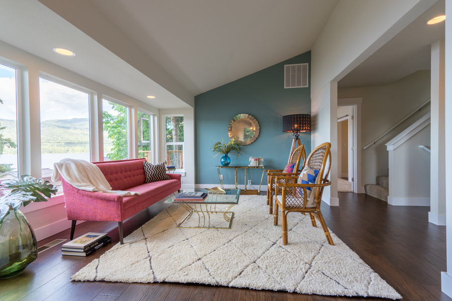 living room of beach house remodel by Bellingham home builders with recessed lighting, and view of lake